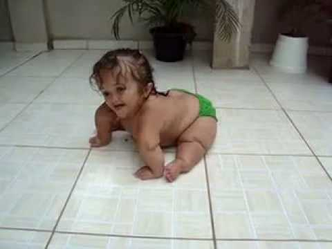 cute weird baby slides around on tiles