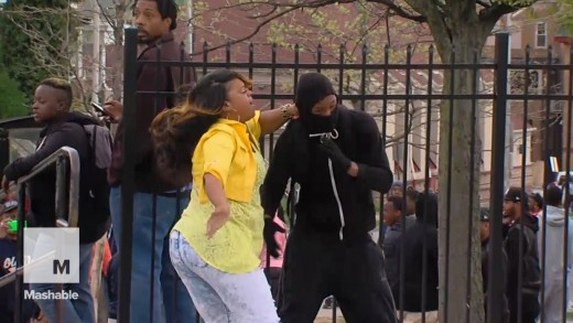 Baltimore mom slaps and scolds rioting son in front of everyone   Mashable