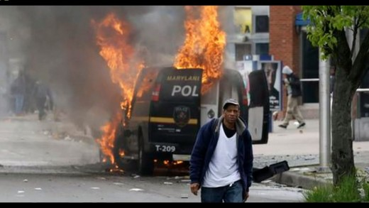 Baltimore Riots: Footage of Cars Torched, Stores Looted After Freddy Gray Funeral