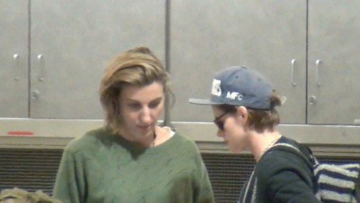Kristen Stewart and Alicia Cargile wait for their bags at LAX Airport
