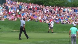 Tiger Woods motors in his 29-foot putt for birdie at the Memorial
