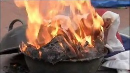 Protest against racism in NY sets American flag on fire