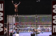 Jimmy Snuka dives off the top of  the steel cage!