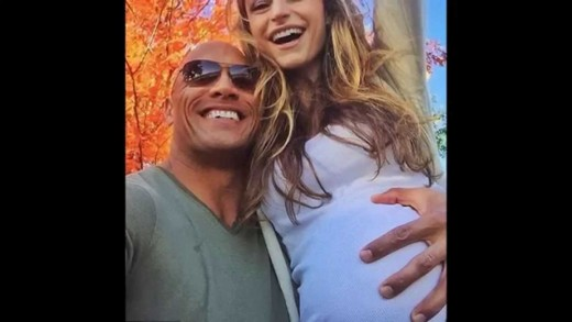 Lauren Hashian -The Rock Dwayne Johnson caresses girlfriend Lauren Hashian's baby bump